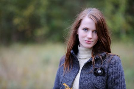 Beautiful young elegant woman in autumn forest Stock Photo - 5533313