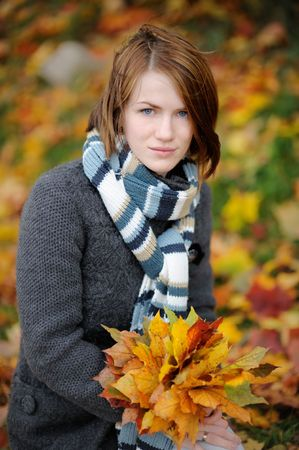 Young beautiful autumn lady in the park photo