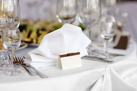 Empty place card on the white festive table Stock Photo