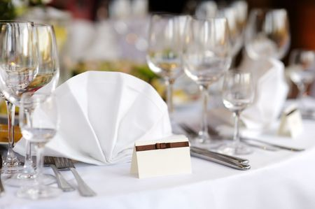 Empty place card on the white festive table photo