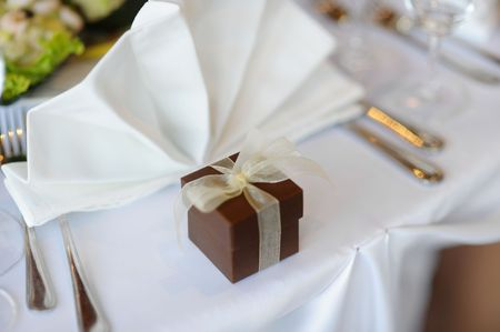Table set for a festive party or dinner with a brown box photo