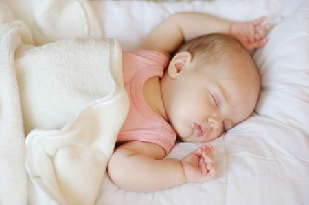 baby love: Sweet little newborn baby sleeping in a bed Stock Photo