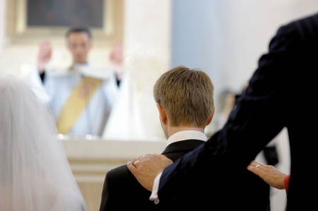 Grooms parent blessing him during wedding ceremony in a church Editorial