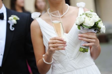 Bride is holding a glass of champagne photo