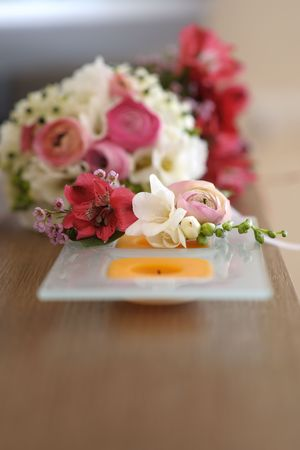 boutonniere: Pink freesia groom boutonniere
