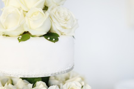 wedding cake: White wedding cake with real roses decorations