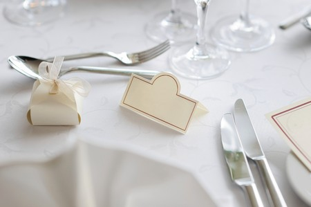 Empty place card on the white festive table Stock Photo - 8000247