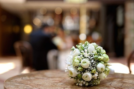 wedding table: White wedding flowers laying on a table