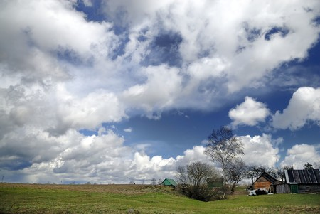 Early spring countryside landscape with beautiful clouds Stock Photo