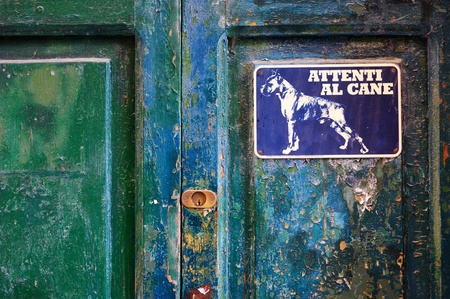 Angry dog sign on a door, Italy photo