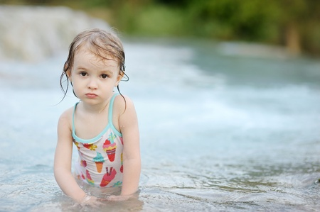 Adorable child in swimming suit on a beach photo