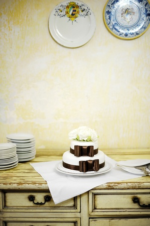 elegant party: Delicious white and brown wedding cake