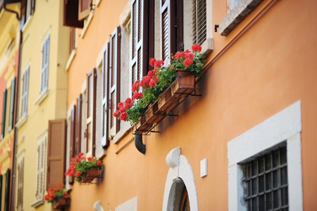 A colorful balcony in Italian town photo