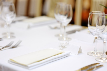 Empty place card on table set for a party