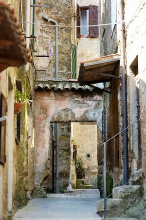 narrow: Narrow street in Pitigliano, Tuscany, Italy Stock Photo