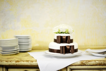 Delicious white and brown wedding cake photo