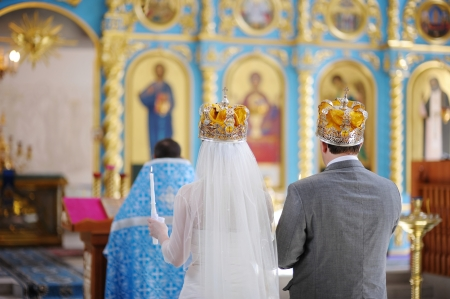 christian altar: Bride and groom in an orthodox wedding ceremony