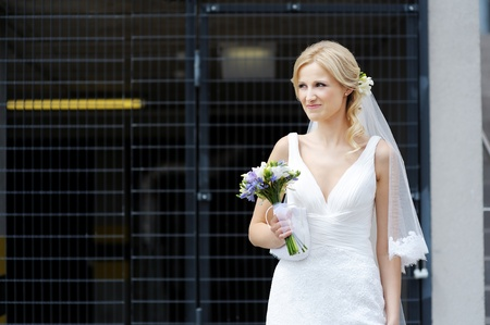The beautiful bride smiling outdoors photo