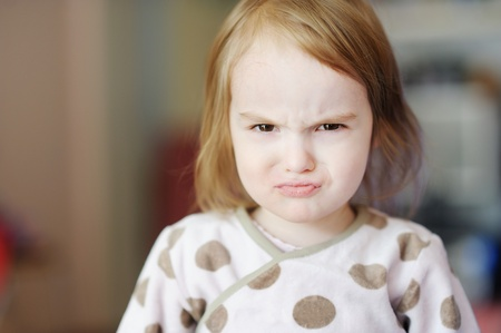 Portrait of little angry toddler girl
