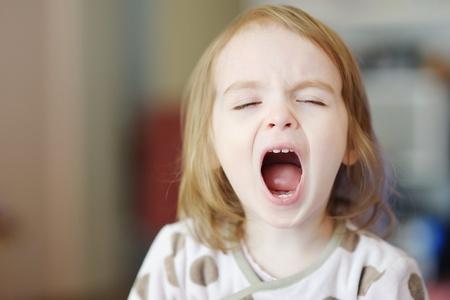 girl tongue: Little funny toddler girl screaming Stock Photo