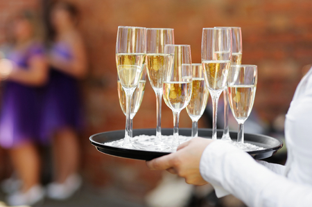skoal: Waiter serving champagne at festive event Stock Photo