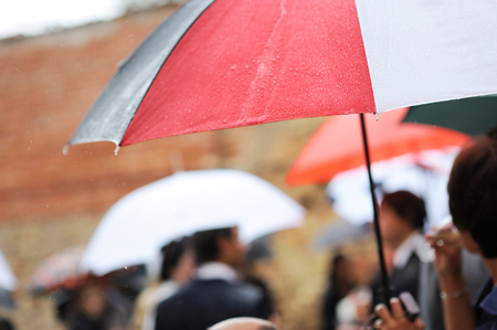 tempest: A colorful umbrella under the rain