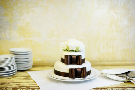 cake stand: Delicious white and brown wedding cake