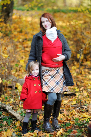 Young mother and her two children at autumn photo
