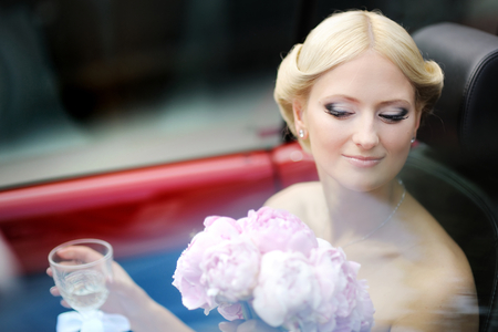 contestant: Beautiful young bride portrait in a car