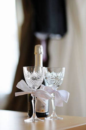 Two empty wedding champagne glasses with a bows photo