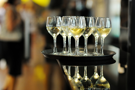 glass table: Few glasses of white wine or champagne Stock Photo