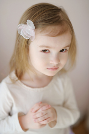 three wishes: Adorable little girl with flower hairclip