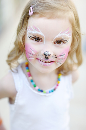 Adorable little girl with kitty painted face