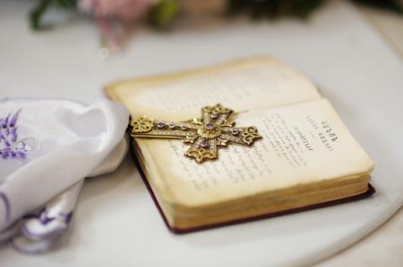 gemstones: Golden cross with gemstones on Holy Bible
