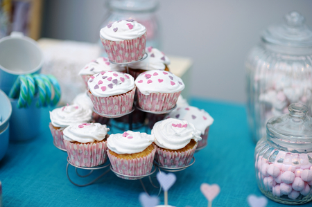 sugarpaste: Delicious colorful wedding cupcakes with hearts icing Stock Photo
