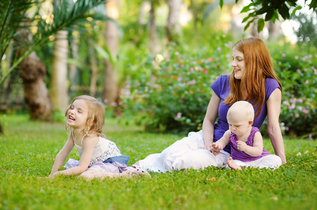 nice accommodations: Young mother and her two little daughters Stock Photo