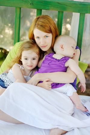 adult care: Mother and her two daughters outdoors