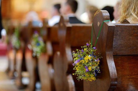 church interior: Beautiful wild flowers wedding decoration in a church