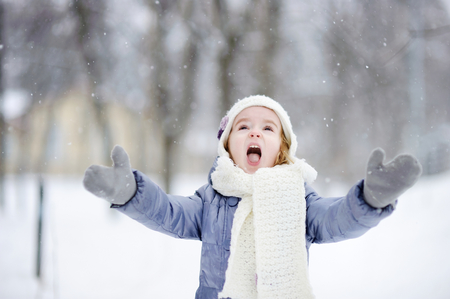 one family: Little girl having fun on winter day