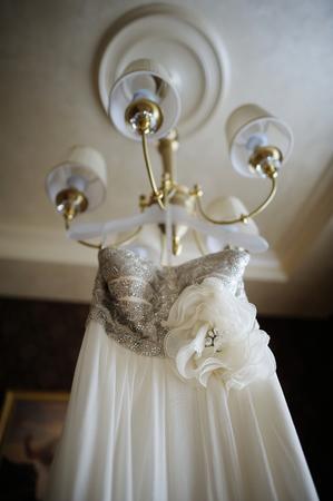 Beautiful White Wedding Dress Hanging Photo