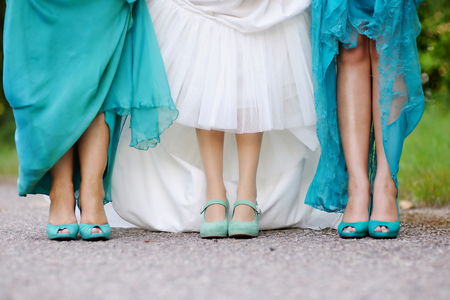 bridesmaids: Bride and bridesmaids show off their shoes at wedding