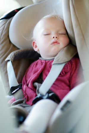 car seat: Infant baby sleeping peacefully in a car seat Stock Photo