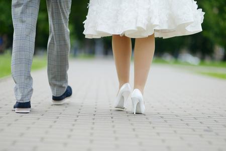 walking away: Bride and groom walking away