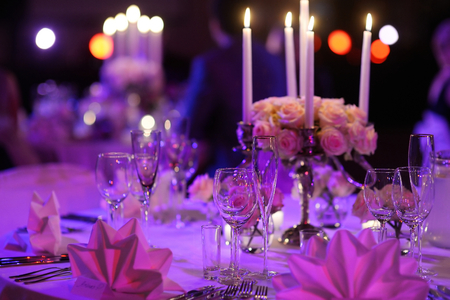 banquet table: Table set for an event party or wedding reception
