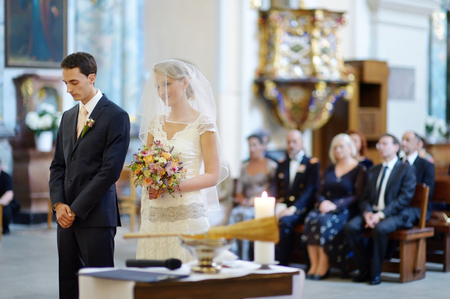 debutante: Bride and groom at the church during a wedding ceremony