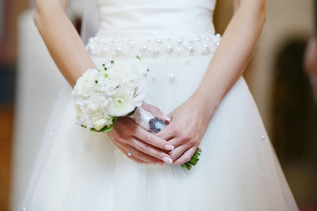 churches: Bride holding flowers at the wedding ceremony in church