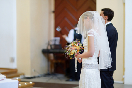 catholic wedding: Bride and groom at the church during a wedding ceremony