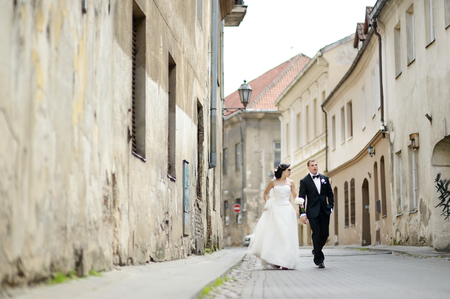 Happy bride and groom walking together photo