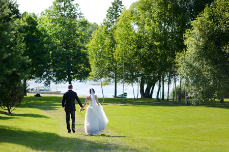 Beautiful bride and groom by a tree photo