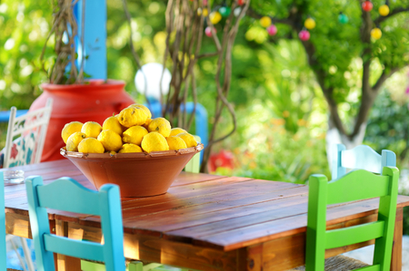 design interior: A dish of lemons in typical greek outdoor cafe on Kos island